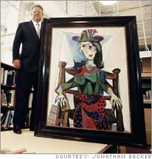 Sotheby's CEO Bill Ruprecht (with Picasso's 'Dora Maar with Cat').