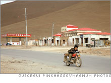 A young man on a motorcycle near Lhasa.